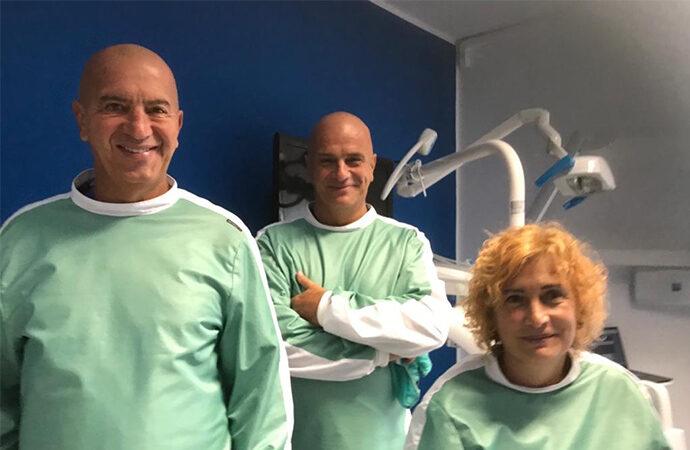 Roberto, Cristiana e Stefano Trova, una generazione di dentisti, il loro padre Antonio  un pioniere